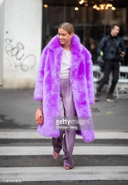 Emili Sindely is seen wearing purple faux fur coat outside Max Mara on Day 2 Milan Fashion Week Autumn/Winter 2019/20 on February 21 2019 in Milan...