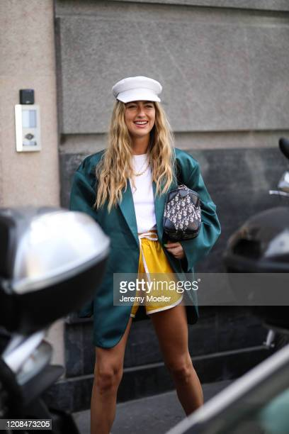 Emili Sindlev is seen wearing a Dior vintage bag and Nike shorts before Sportmax during Milan Fashion Week Fall/Winter 20202021 on February 21 2020...