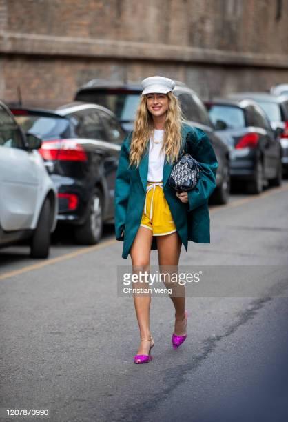 Emili Sindlev is seen wearing baker boy hat, yellow shorts, green blazer, Dior bag outside Sportmax during Milan Fashion Week Fall/Winter 2020-2021...