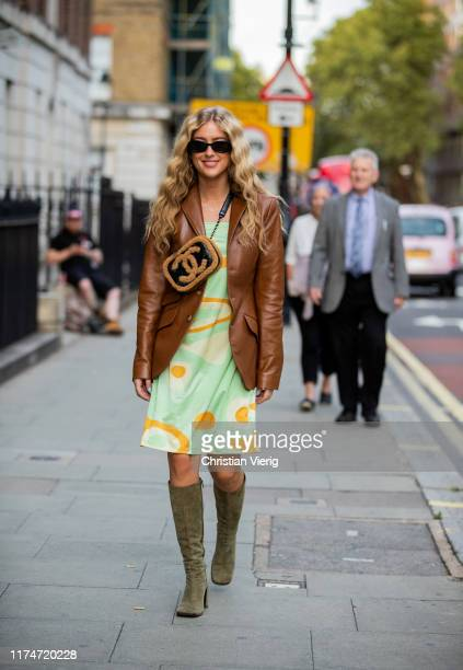 Emili Sindlev is seen wearing Chanel bag brown jacket dress with print olive boots outside Rejina Pyo during London Fashion Week September 2019 on...