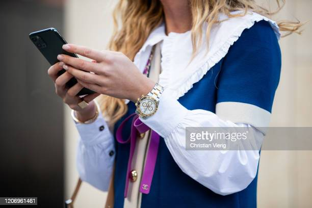 Emili Sindlev is seen wearing Chanel jacket Fendi bag Rolex Daytona watch in silver and gold outside Christopher Kane during London Fashion Week...