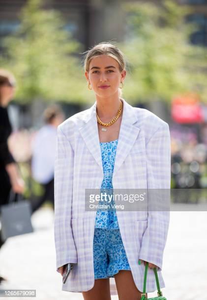 Emili Sindlev is seen wearing checkered oversized blazer green Fendi bag blue dress outside Helmstedt during Copenhagen Fashion Week Spring/Summer...