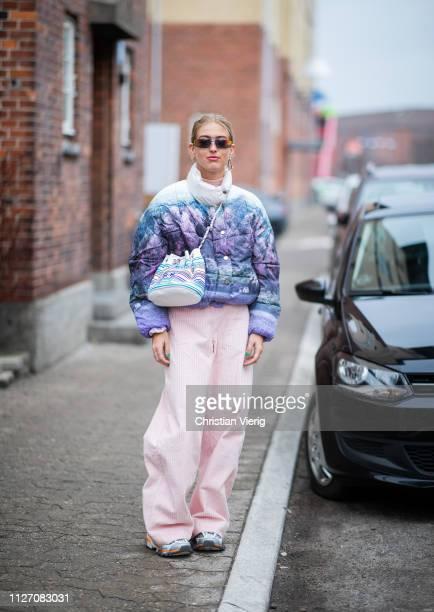 Emili Sindlev is seen wearing cropped jacket Chanel bag pink wide leg pants outside Baum und Pferdgarten during the Copenhagen Fashion Week...