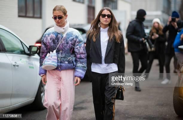 Emili Sindlev is seen wearing cropped jacket Chanel bag pink wide leg pants and Sophia Roe outside Baum und Pferdgarten during the Copenhagen Fashion...