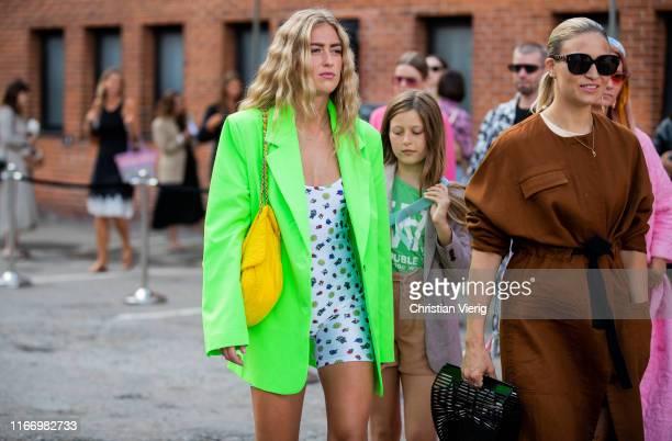 Emili Sindlev is seen wearing neon green blazer outside By Malene Birger during Copenhagen Fashion Week Spring/Summer 2020 on August 08, 2019 in...