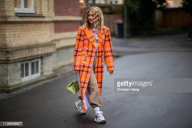 Emili Sindlev is seen wearing orange plaid coat outside By Malene Birger during the Copenhagen Fashion Week Autumn/Winter 2019 Day 3 on January 31...