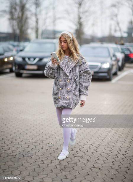 Emili Sindlev is seen wearing plaid double breasted jacket pink tights outside Munthe during the Copenhagen Fashion Week Autumn/Winter 2019 Day 3 on...