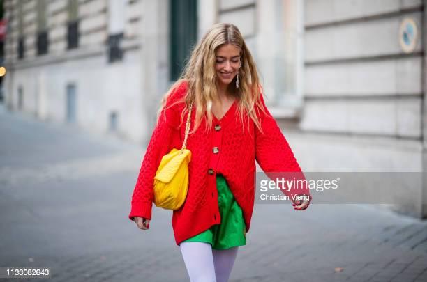 Emili Sindlev is seen wearing red cardigan during Paris Fashion Week Womenswear Fall/Winter 2019/2020 on March 01, 2019 in Paris, France.