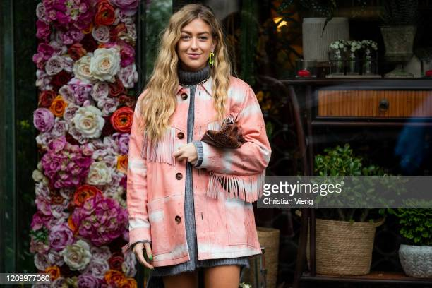 Emili Sindlev is seen wearing salmon colored jacket with fringes, grey knitted turtleneck dress outside Sacai during Paris Fashion Week - Womenswear...