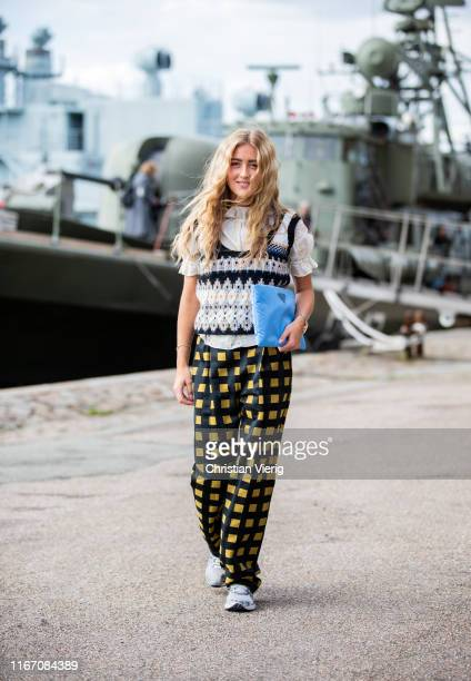 Emili Sindlev is seen wearing yellow black plaid pants outside Stine Goya during Copenhagen Fashion Week Spring/Summer 2020 on August 08 2019 in...