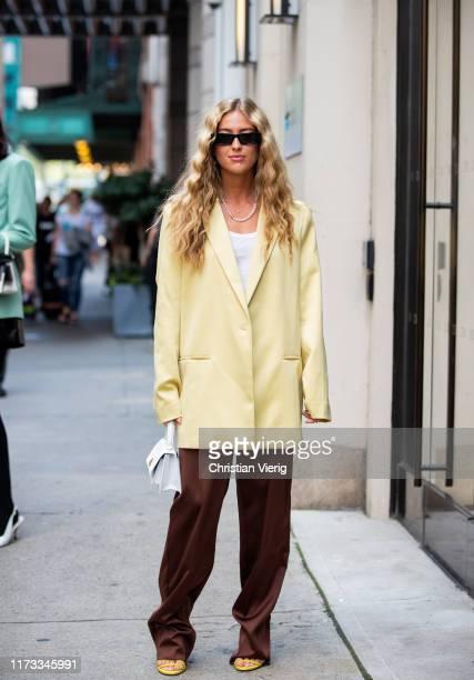 Emili Sindlev is seen wearing yellow oversized blazer brown pants outside Tibi during New York Fashion Week September 2019 on September 08 2019 in...