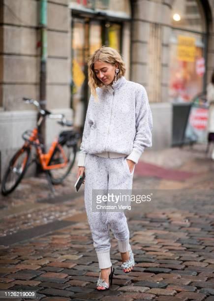 Emili Sindlev is seen wearing zipped jacket, jogger pants, heels, earring outside Holzweiler during the Copenhagen Fashion Week Autumn/Winter 2019 -...