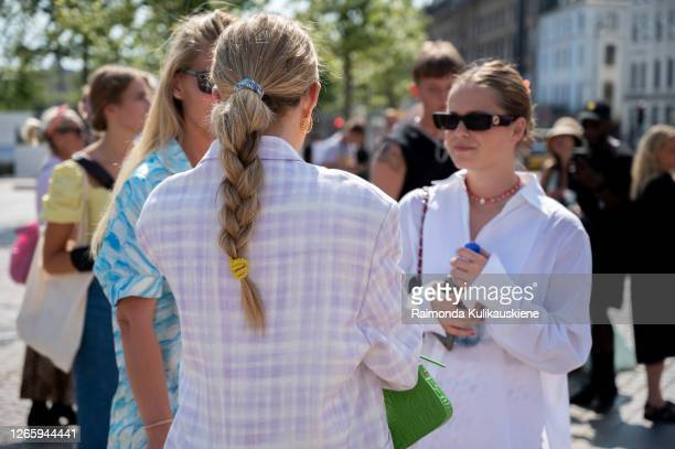 Emili SIndlev outside Helmstedt wearing white/purple checked blazer and green bag during Copenhagen fashion week SS21 on August 12, 2020 in...
