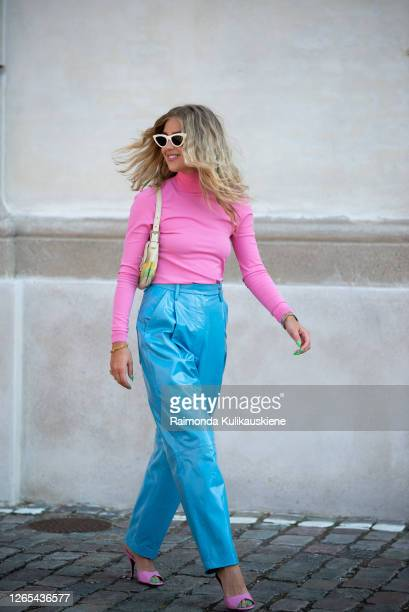 Emili Sindlev outside Remain Birger Christensen wearing blue leather pants and pink shirt during Copenhagen fashion week SS21 on August 11, 2020 in...