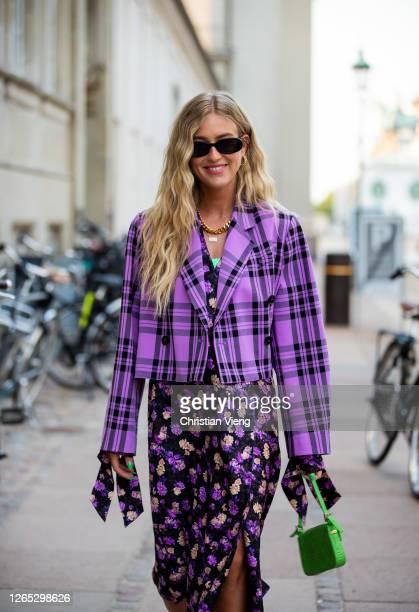 Emili Sindlev seen wearing checkered purple cropped blazer skirt with slit and floral print green Fendi bag outside Baum und Pferdgarten during...