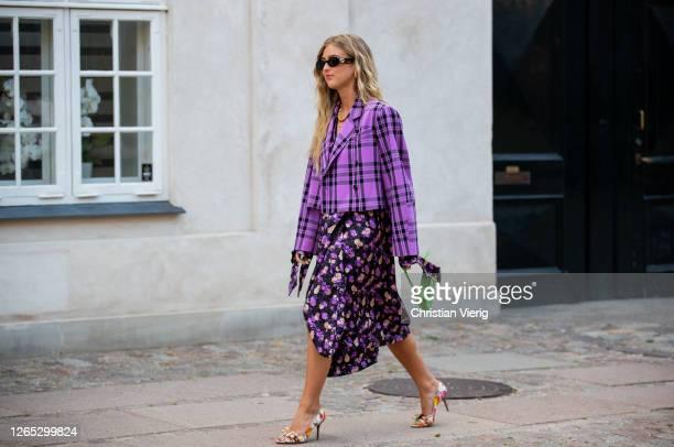 Emili Sindlev seen wearing checkered purple cropped blazer, skirt with slit and floral print, green Fendi bag outside Baum und Pferdgarten during...