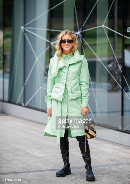 Emili Sindlev seen wearing green button up dress vest striped Chanel bucket bag black boots outside the Sportmax show during Milan Fashion Week...