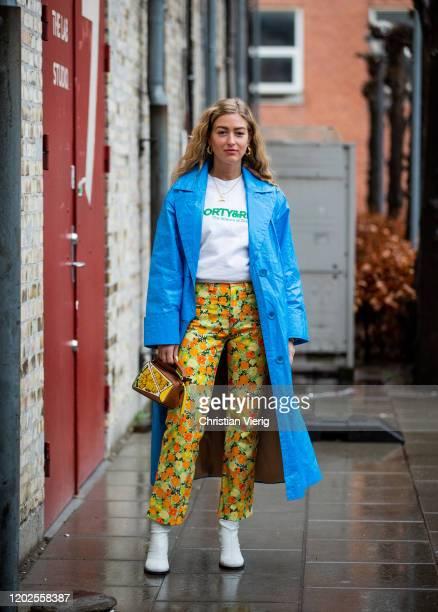 Emili Sindlev seen wearing pants with floral print, mini Loewe bag, blue coat outside Carcel on Day 1 during Copenhagen Fashion Week Autumn/Winter...