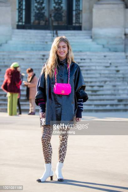 Emili Sindlev seen wearing pink Chanel bag black jacket with short sleeves thights with animal print outside Chanel during Paris Fashion Week Haute...