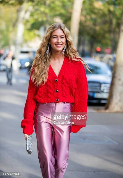 Emili Sindlev seen wearing pink silk pants, red cropped cardigan outside Alessandra Rich during Paris Fashion Week Womenswear Spring Summer 2020 on...
