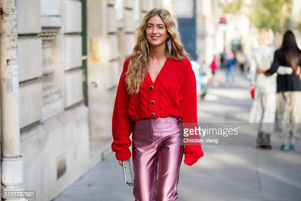 Emili Sindlev seen wearing pink silk pants red cropped cardigan outside Alessandra Rich during Paris Fashion Week Womenswear Spring Summer 2020 on...