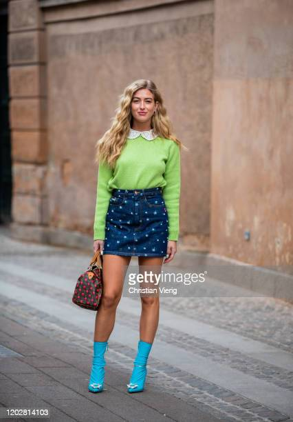 Emili Sindlev seen wearing skirt with print green jumper Louis Vuitton bag blue ankle boots outside Mark Kenly Domino Tanduring Copenhagen Fashion...