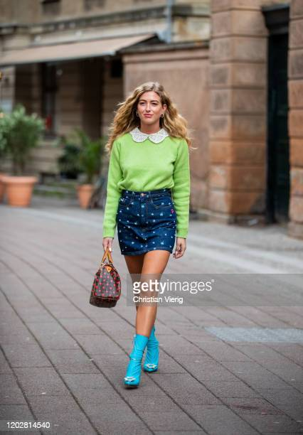 Emili Sindlev seen wearing skirt with print, green jumper, Louis Vuitton bag, blue ankle boots outside Mark Kenly Domino Tanduring Copenhagen Fashion...