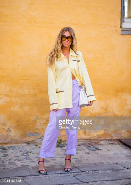 Emili Sindlev weairng purple pants yellow jacket is seen outside Lovechild 1979 during the Copenhagen Fashion Week Spring/Summer 2019 on August 9...