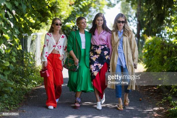 Emili Sindlev wearing a blouse red flared pants Janka Polliani wearing green coat Gucci bag Darja Barannik wearing skirt with floral print pink...