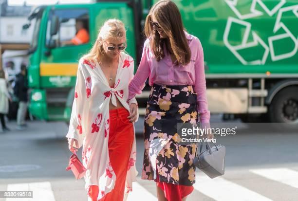 Emili Sindlev wearing a blouse red flared pants outside iis Woodling and Darja Barannik wearing a skirt with floral print pink blouse grey Balenciaga...