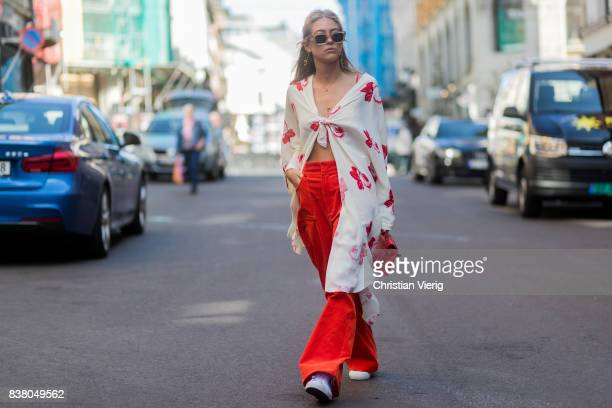 Emili Sindlev wearing a blouse red flared pants outside iis Woodling on August 23 2017 in Oslo Norway