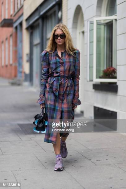 Emili Sindlev wearing a checked dress Air Max seen in the streets of Manhattan outside Jason Wu during New York Fashion Week on September 8 2017 in...