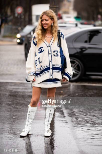 Emili Sindlev wearing a cream and blue long cardigan with matching skirt white boots and blue bag is seen outside Chanel on Day 9 Paris Fashion Week...