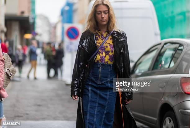 Emili Sindlev wearing a denim midi skirt blouse with floral print rain coat outside Bik Bok Runway Award on August 24 2017 in Oslo Norway
