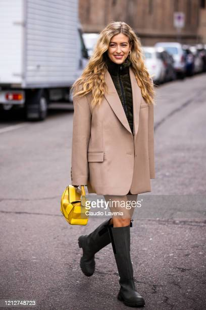 Emili Sindlev wearing a green fur jumper beige blazer green boots and yellow bag is seen outside Max Mara show during Milan Fashion Week Fall/Winter...
