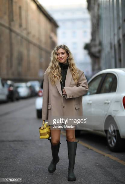 Emili Sindlev wearing a Loewe bag and Ganni boots outside Max Mara during Milan Fashion Week Fall/Winter 2020-2021 on February 19, 2020 in Milan,...