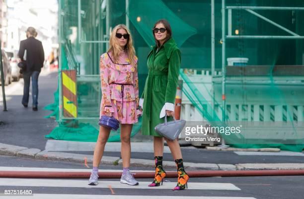 Emili Sindlev wearing a pink dress with floral print sneakers striped socks and Darja Barannik wearing Balenciaga bag green coat Balenciaga sock...
