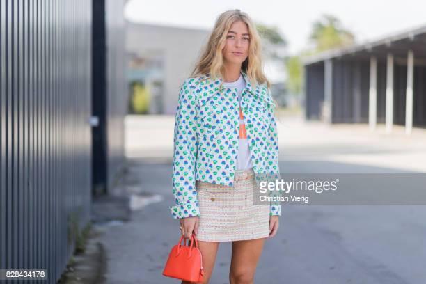 Emili Sindlev wearing a red Prada bag turquoise blazer mini skirt outside By Malene Birger on August 09 2017 in Copenhagen Denmark