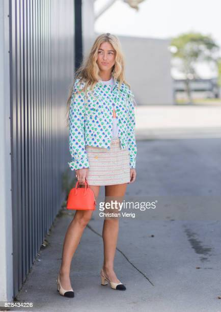 Emili Sindlev wearing a red Prada bag, turquoise blazer, mini skirt, Chanel shoes outside By Malene Birger on August 09, 2017 in Copenhagen, Denmark.