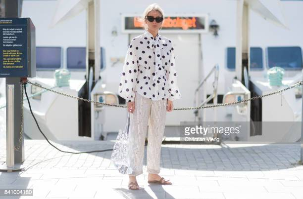 Emili Sindlev wearing a white blouse with dots, transparent bag, sandals outside Whyred on August 30, 2017 in Stockholm, Sweden.