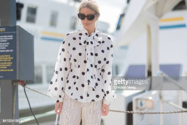 Emili Sindlev wearing a white blouse with dots transparent bag sandals outside Whyred on August 30 2017 in Stockholm Sweden