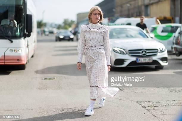 Emili Sindlev wearing a white ruffled dress outside Ganni on August 10 2017 in Copenhagen Denmark