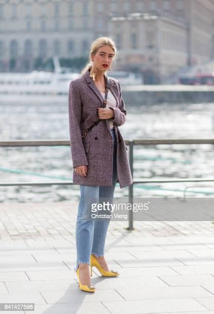 Emili Sindlev wearing blazer jacket Louis Vuitton bag denim jeans outside House of Dagmar on August 31 2017 in Stockholm Sweden