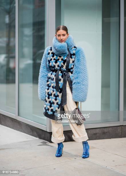 Emili Sindlev wearing blue coat beige wide pants seen outside SelfPortrait on February 10 2018 in New York City