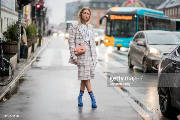 Emili Sindlev wearing checked blazer checked skit Chanel bag socks heels outside Anne Vest during the Copenhagen Fashion Week Autumn/Winter 18 on...
