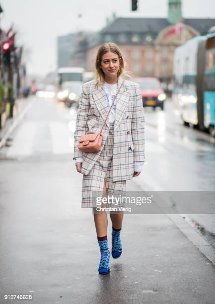 Emili Sindlev wearing checked blazer checked skit Chanel bag socks heels outside Anne Vest during the Copenhagen Fashion Week Autumn/Winter 18 on...