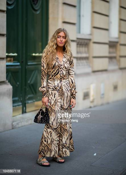 Emili Sindlev wearing dress with animal print is seen outside Alessandra Rich during Paris Fashion Week Womenswear Spring/Summer 2019 on September 28...