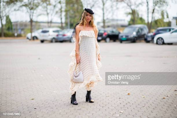 Emili Sindlev wearing dress with dots print, black hat with net is seen outside Holzweiler during the Copenhagen Fashion Week Spring/Summer 2019 on...