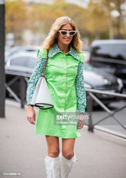 Emili Sindlev wearing green dress white boots Chanel bag is seen outside Miu Miu during Paris Fashion Week Womenswear Spring/Summer 2019 on October 2...