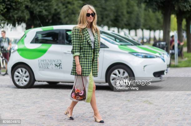 Emili Sindlev wearing green skirt and plaid blazer jacket Chanel shoes outside Baum Und Pferdgarten on August 10 2017 in Copenhagen Denmark